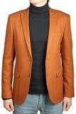 人的橙色夹克衣服 免版税库存照片