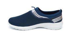人的蓝色休闲鞋子 图库摄影