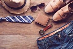 人的衣物在木地板上 图库摄影