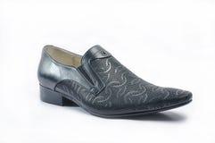人的黑snakeskin鞋子 免版税图库摄影