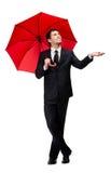 人的Palming有红色伞的检查雨 图库摄影