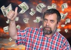 人的tumb和金钱雨 免版税库存图片