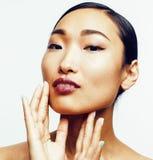 年轻人相当亚裔妇女用在白色背景隔绝的面孔的手,时髦的时尚医疗保健人概念 库存照片