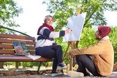 人看起来女孩画画家 库存照片