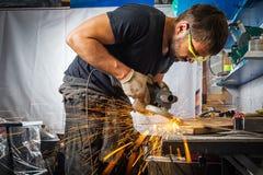 人研磨机金属角度研磨机 免版税库存图片