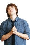 年轻人祈祷 免版税库存照片