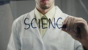 人科学家在玻璃写词`科学` 股票视频