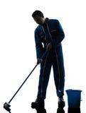 人管理员擦净人清洁剪影 免版税库存照片