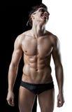 人肌肉性感弄湿了 免版税图库摄影
