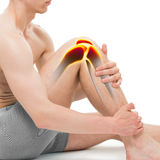 年轻人膝盖在白色隔绝的痛苦解剖学 免版税图库摄影