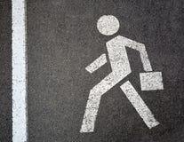人行道的标志在沥青的 库存图片