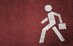 人行道的标志在红色背景的 生意人 免版税库存照片
