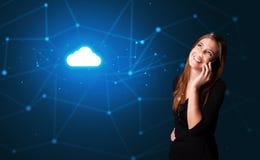 人谈话在有云彩技术概念的电话 免版税库存图片