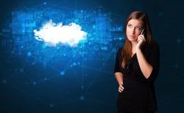 人谈话在有云彩技术概念的电话 免版税图库摄影