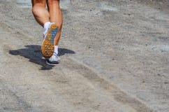 人赛跑的腿 免版税库存照片