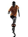 年轻人足球运动员剪影 免版税库存图片