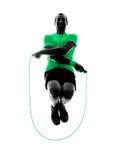 人跳绳行使健身剪影 免版税库存照片
