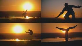 人运动员是在橙色日落- 4前面的执行的capoeira战斗在1 库存照片