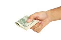 人递拿着在白色背景的一百元钞票 免版税库存图片