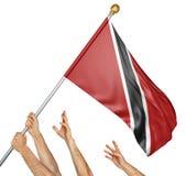 人队递培养特立尼达和多巴哥国旗 免版税库存图片