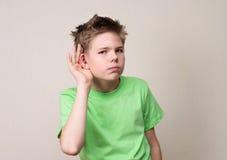 人面表示,情感,肢体语言 好奇青春期前b 免版税库存照片