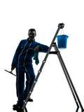 人风窗清洁器工作者剪影 免版税图库摄影
