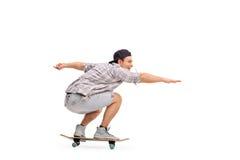 人骑马滑板年轻人 库存照片