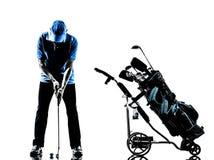 人高尔夫球运动员打高尔夫球的高尔夫球袋剪影 免版税库存图片
