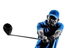 人高尔夫球运动员打高尔夫球的画象剪影 免版税库存图片