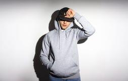 人,空白的黑色的人,棒球帽,灰色hoody 库存照片