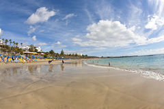 人们享用人为海滩 库存照片