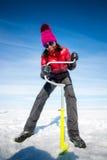 人钻冰在冬天 免版税库存照片