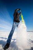 人钻冰在冬天 免版税库存图片
