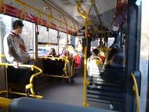 人们在公共汽车华沙上 库存照片