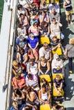 人们在巴黎享受在河塞纳河的小船旅行 免版税库存图片