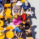 人们在巴黎享受在河塞纳河的小船旅行 免版税库存照片