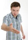 年轻人给手震动 库存图片