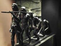 人类演变铜雕塑 免版税库存图片