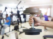 人锻炼的被弄脏的图象在体育俱乐部的 库存照片