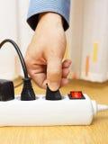 人从电源板的被拔去的插座 免版税库存照片