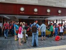 人们站立近的注册柜台 库存图片