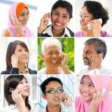 人们谈话在电话。 库存图片