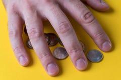 人` s手包括硬币 货币保护您 缺钱 免版税库存照片