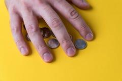 人` s手包括硬币 货币保护您 缺钱 免版税库存图片