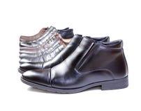 人` s鞋子连续被投入 免版税图库摄影