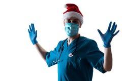 人Surgeon In Christmas圣诞老人医生帽子 库存照片