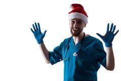 人Surgeon In Christmas圣诞老人医生帽子 免版税库存图片