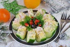从一个新鲜的黄瓜的开胃菜用蟹肉、鸡蛋、乳酪和莳萝 库存照片