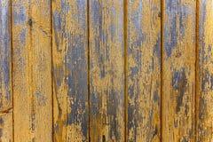从一个木破旧的板条的背景 免版税库存照片