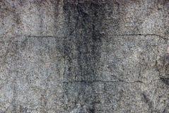 从一个灰色黑混凝土墙的石纹理 免版税图库摄影